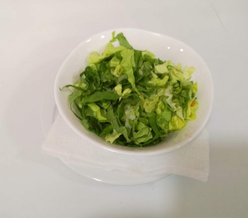 Green salad served as a side dish.