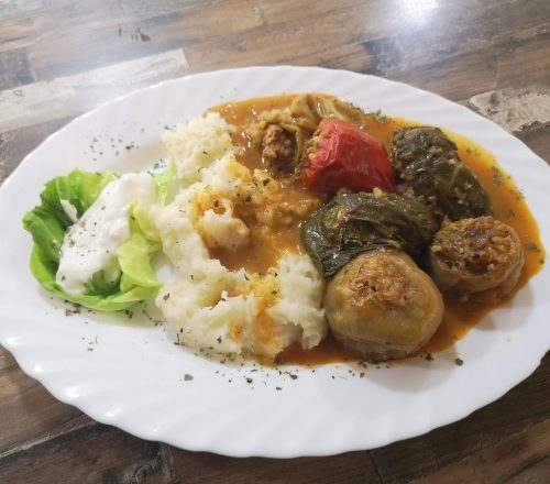 Japrak, Dolma and Sogan Dolma served with mashed potatoes and soured cream on the side.