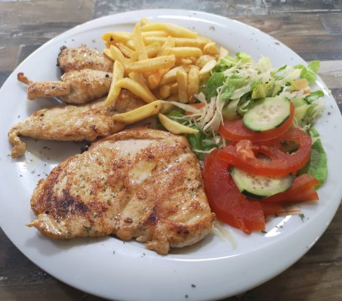Grilled chicken served with french fries and salad on a white plate.