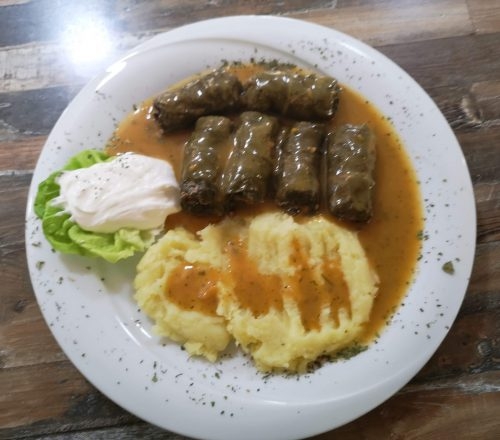 Traditional japrak meal served with mashed potatoes and soured cream.