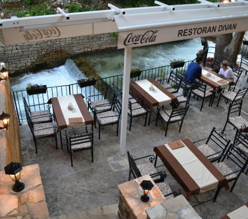Restaurant terrace and outdoor seating with a view on the river.